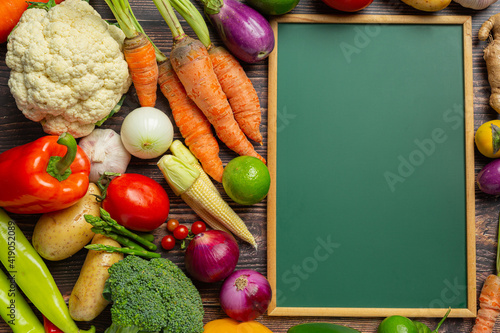 Canvas-taulu chalkboard with healthy vegetables on old dark background,World food day