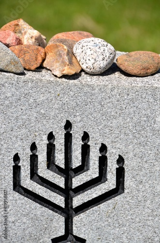 Wallpaper Mural Leaving Stones on Jewish Grave stones is a way to pay homage to the deceased