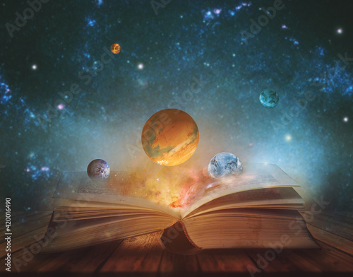 Book of the universe - opened magic book with planets and galaxies Fotobehang