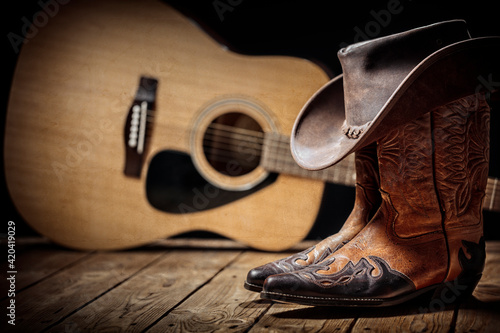 Obraz na plátne Country music festival live concert with acoustic guitar, cowboy hat and boots
