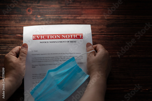 Obraz na plátně A woman holds an eviction notice for non-payment