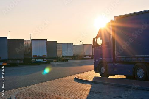 Obraz na plátne Loaded trucks parked in waiting area on border crossing
