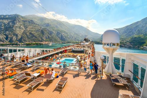 Carta da parati Tourists on a large cruise ship on Boka Bay near Perast heading towards the Kotor Montenegro cruise port on the Adriatic Sea