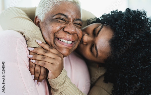 Photo Happy Hispanic mother and daughter having tender moment together - Parents love