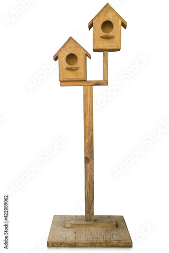 Leinwand Poster Wooden bird house isolated on a white background.