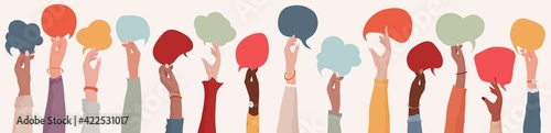 Fotografia Group Raised arms of diversity multi-ethnic multicultural women holding speech bubble in hand