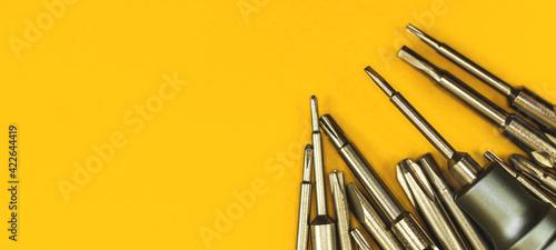 Fotografia Repair equipment background, screwdriver tool with metal bits background banner,