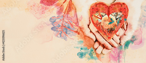 Heart in hand. Conceptual watercolor banner.