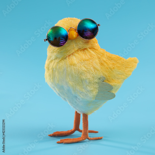 Photo Easter decoration of a yellow chick wearing silly sunglasses.