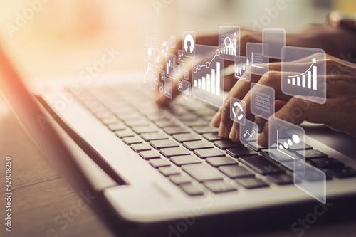 Obraz na płótnie Businesswoman using laptop in data management.