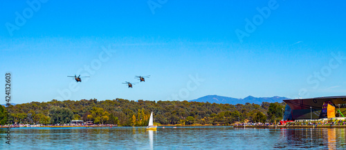 Obraz na płótnie Black Hawk helicopters flying overhead at Lake Burley Griffin during an aerial f
