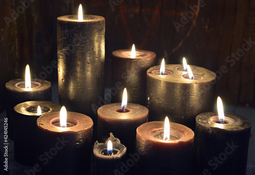 Obraz na plátně Still life with group of burning candles on witch altar.