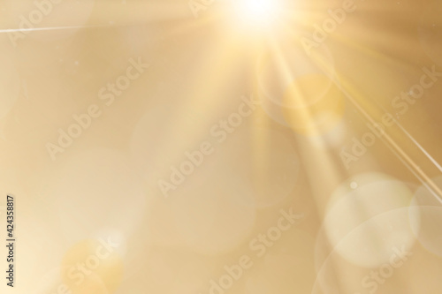 Fotografie, Obraz Natural light lens flare on gold background sun ray effect