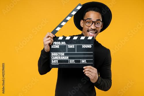 Young happy smiling fun cheerful african man 20s wearing stylish black shirt hat Fototapet