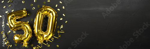 Foto golden foil balloon number fifty