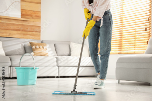 Obraz na płótnie Woman cleaning floor with mop at home, closeup