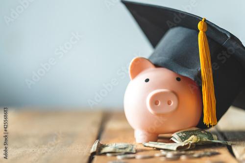 Canvas Print piggy bank With Graduation Cap on old wood,Money saving concept.