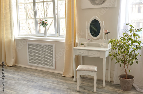 Fotografering portrait of vintage vanity table set with stool and mirror
