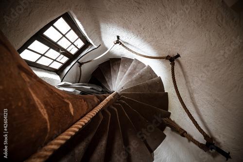 Murais de parede An ancient spiral staircase in a rich medieval house.