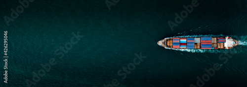 Fotografia Container ship for import and export, business logistic and transportation by container ship in open sea, Aerial top view container cargo ship with copy space for design banner web background