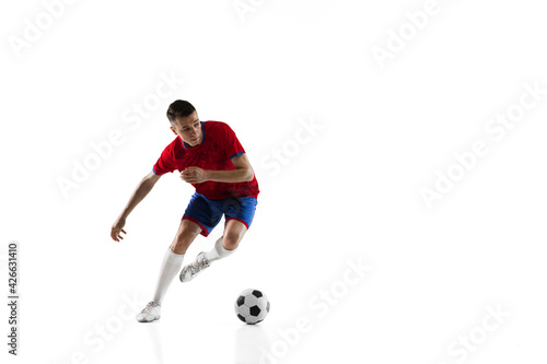 Fotografia Young Caucasian soccer football player training isolated on white background