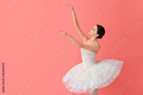 Fotografiet Beautiful young ballerina on color background