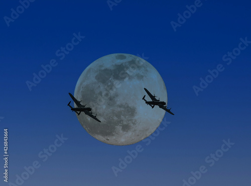 Fotografija The last two remaining airworthy Avro Lancasters heavy bombers silhouetted by a