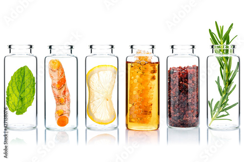 Stampa su Tela The glass bottle of homemade skin care and body scrubs with natural ingredients himalayan salt ,peppermint ,rosemary,turmeric and honey isolate on white background