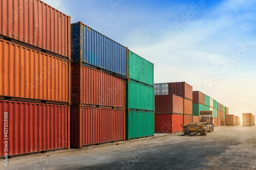 Container stacking cargo with  trailer transport truck working in shipping harbo Fototapet