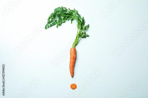 Fototapeta Question mark made of carrot on white background