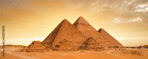 Obraz na plátně Great Pyramids of Giza, Egypt, at sunset