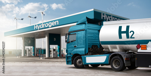Fotografie, Obraz Truck with hydrogen fuel tank trailer on a background of H2 filling station