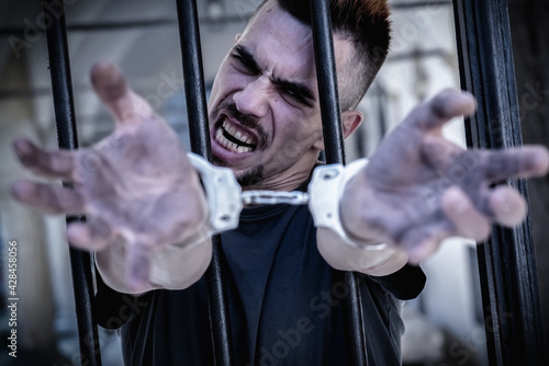 Fotografering Close up handcuffed man imprisoned for crime, punished for serious villainy