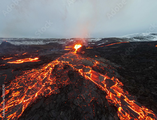 Photo lava eruption volcano aerial view drone view from Iceland of Hot lava and magma