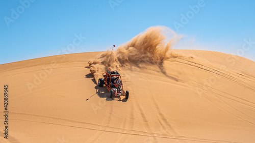 Billede på lærred Dune Buggy In the Desert