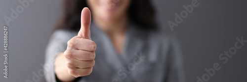 Valokuva Modern business woman showing thumb up in office closeup