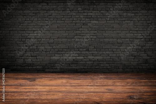 Foto rustic interior, old wood floor and black brick wall