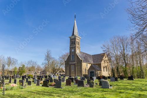 Foto Historic Nicolaaskerk church and graveyard of Hemelem