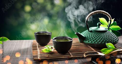 Tablou Canvas Japanese Tea - Hot Teapot And Teacups On Bamboo Mat