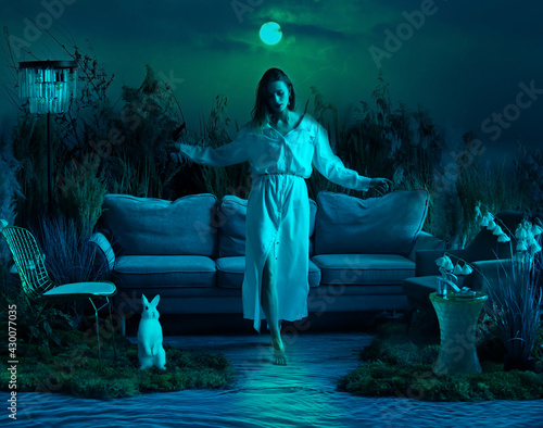 Beautiful girl walks on a moonlit path on the water Fototapeta