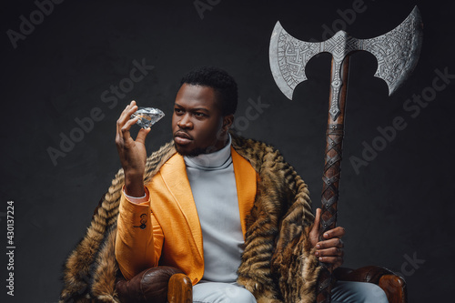Fotografie, Tablou Bizarre african guy with huge axe and diamond