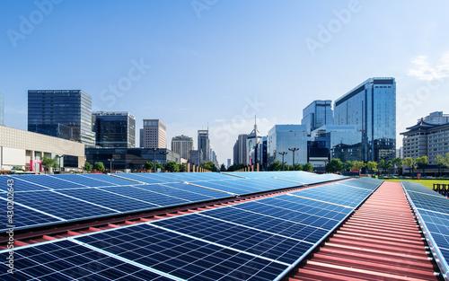 Fényképezés City and photovoltaic panel combined with landscape