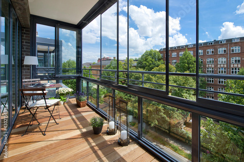 Canvas Print balcony in a modern apartment with furniture, flowers and city views, 3d render