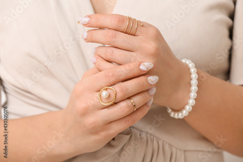 Slika na platnu Young woman with beautiful manicure and accessories, closeup