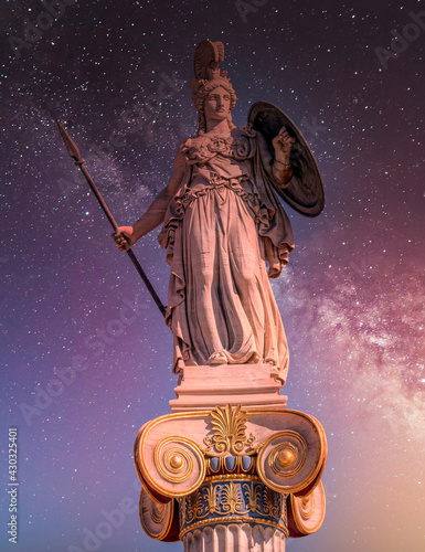 Wallpaper Mural Athena the ancient Greek goddess of wisdom and knowledge under starry night sky,