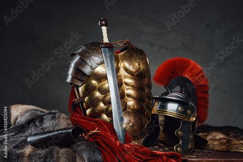 Fototapeta Studio shot of ancient legionary armoring and sword