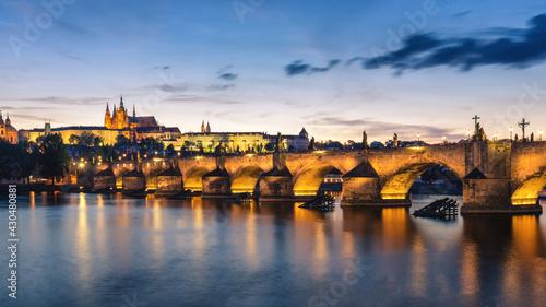 Obraz na plátně View of Prague Castle and Charles Bridge at sunset. Czechia