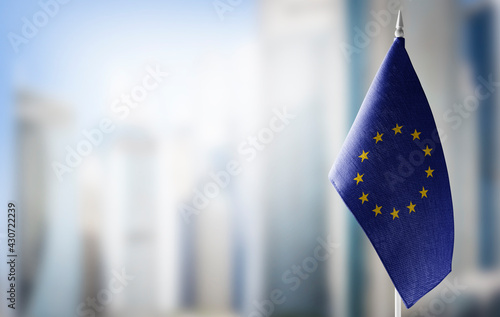 Fotografia Small national flags of the European Union on a light blurry background