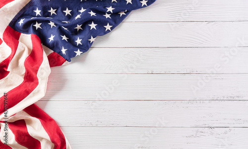Fotografie, Obraz Happy memorial day concept made from vintage american flag on white wooden background