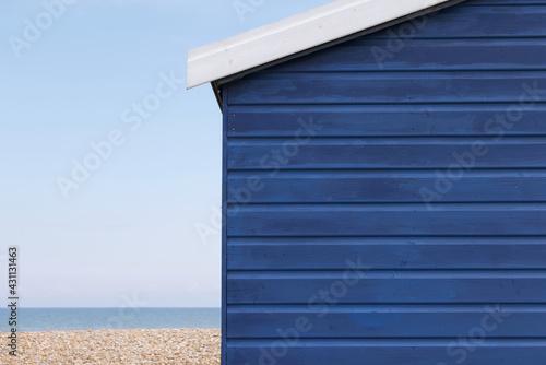 Wallpaper Mural Dark blue beach hut with copy space horizon and beach visible